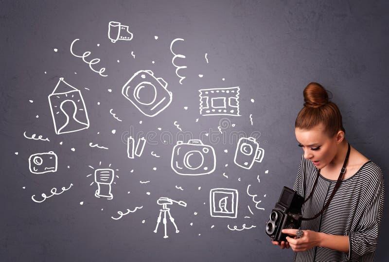 摄影师女孩射击摄影象 免版税库存照片