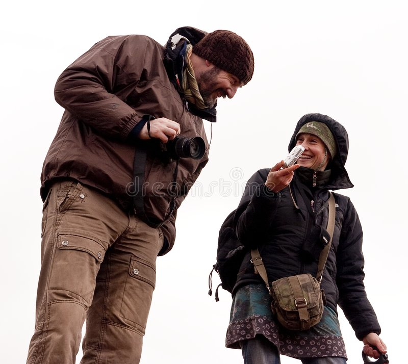 摄影师徒步旅行队微笑 免版税库存图片