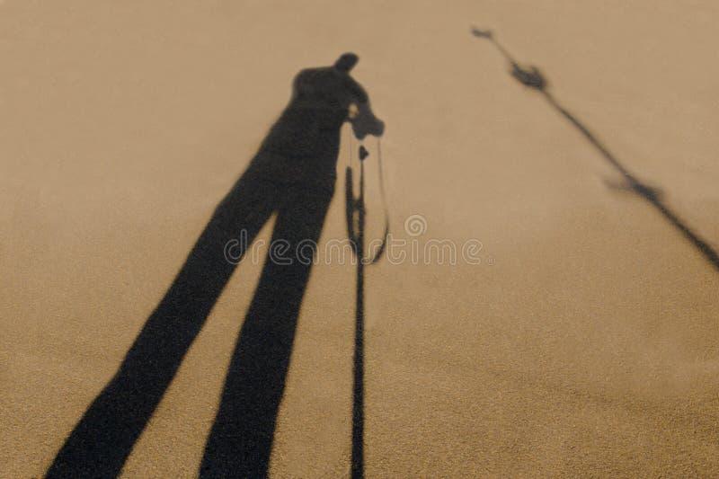 摄影师的阴影,当拍摄对象时 免版税库存照片