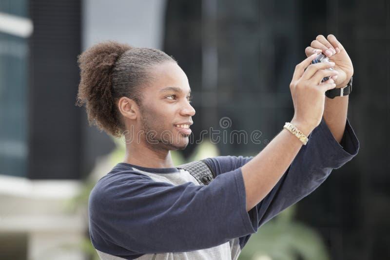 摄影师纵向自采取 免版税库存图片