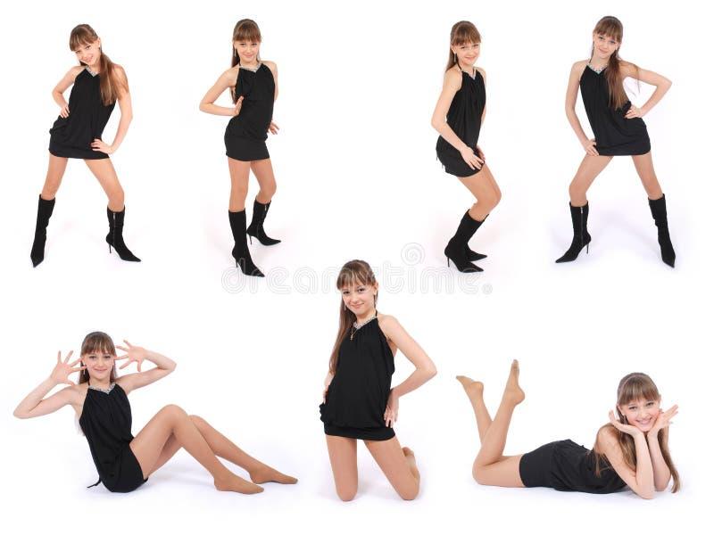 摆在七工作室的黑色礼服女孩姿势 免版税库存照片