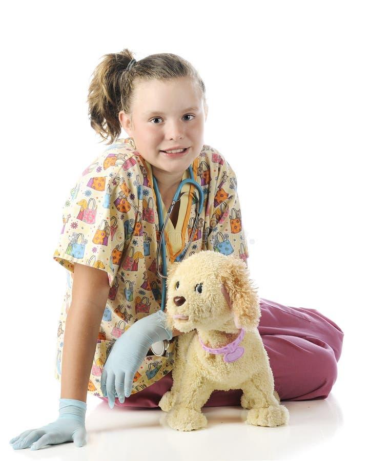 摆在与宠物的年轻狩医 库存图片