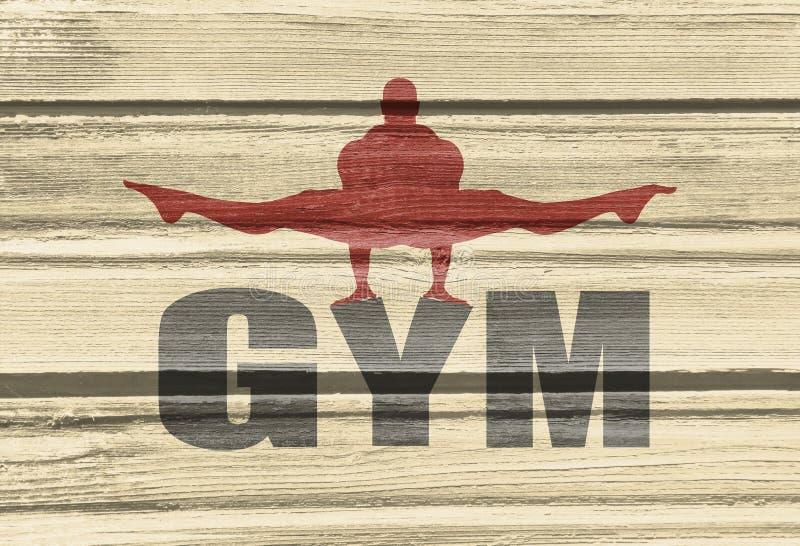 摆在健身房词的肌肉人 库存照片