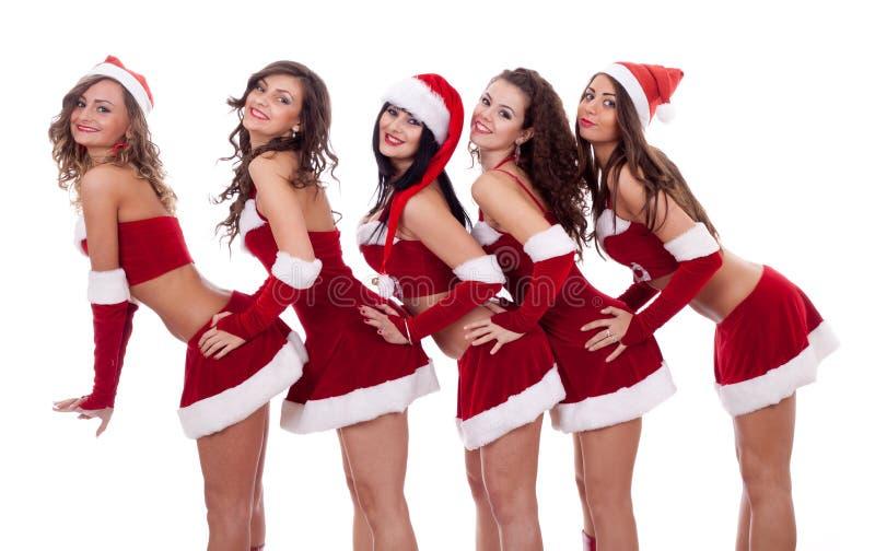 摆在圣诞老人的女孩 免版税图库摄影