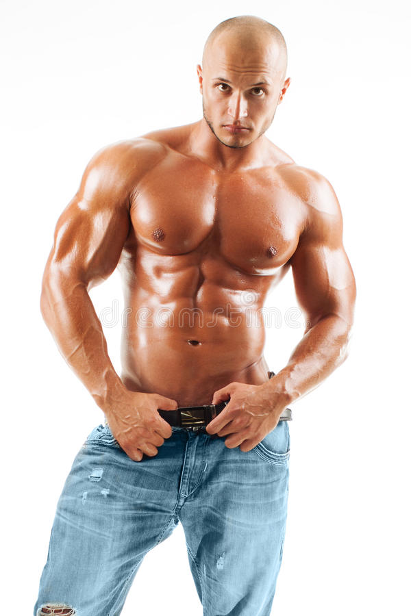 摆在工作室的肌肉的男性设计 库存图片