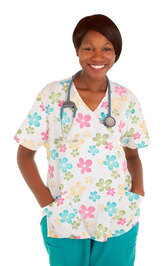 摆在微笑的非洲裔美国人的护士 库存照片