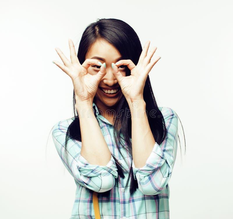 摆在快乐情感的年轻人相当亚裔妇女隔绝在白色背景,生活方式人概念 免版税库存照片