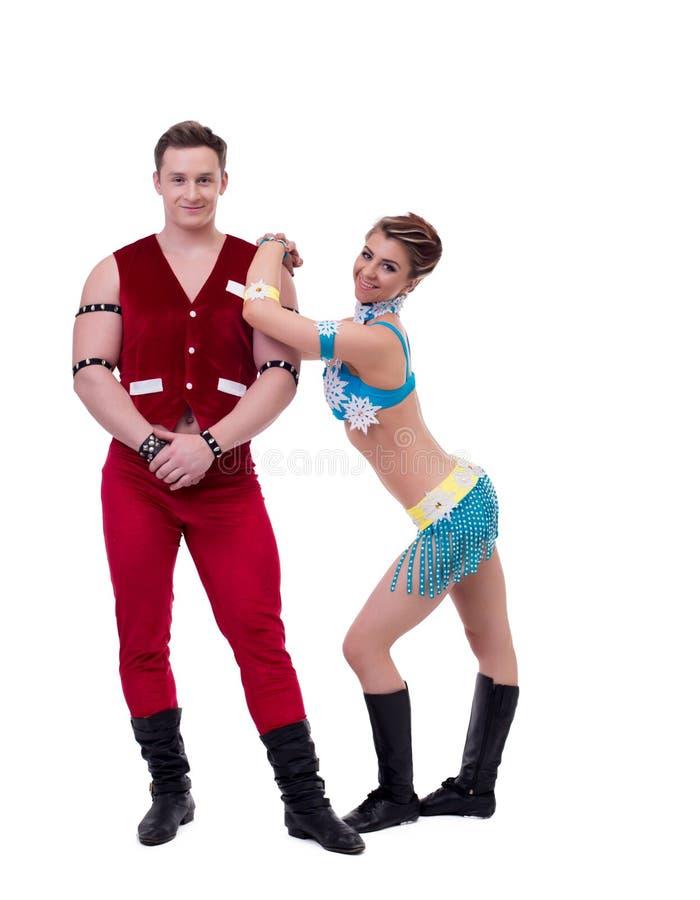 摆在新年服装的英俊的舞蹈家 免版税图库摄影