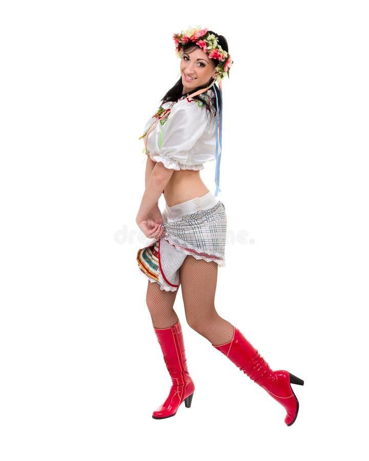 摆在波兰全国传统的服装的,反对被隔绝的白色的全长画象女孩 库存照片