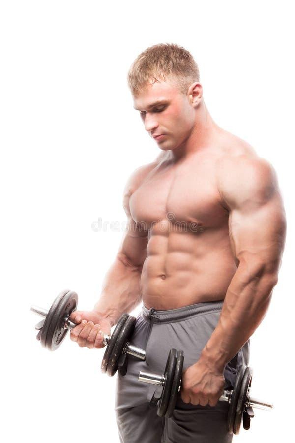 摆在演播室的肌肉人的图象 做二头肌 免版税图库摄影
