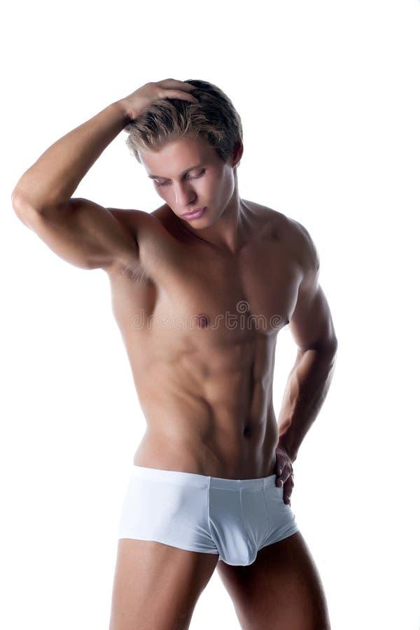 摆在白色摘要的有吸引力的肌肉厚片 免版税库存照片