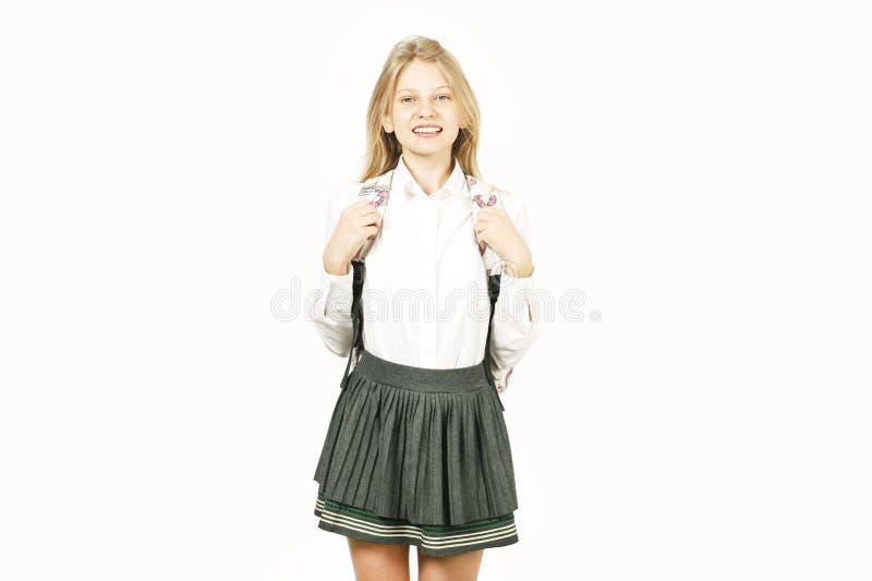 摆在白色的年轻美丽的少年模型女孩隔绝了显示情感表情的背景 免版税图库摄影