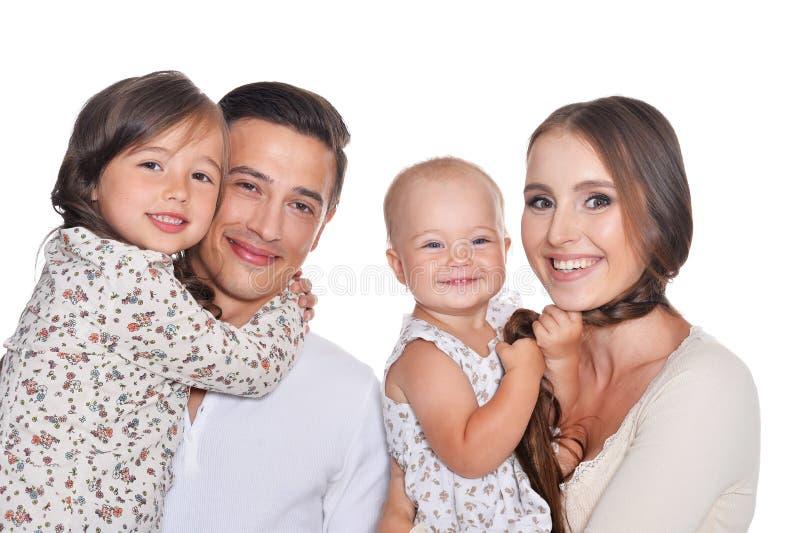 摆在白色背景的幸福家庭四 免版税库存照片