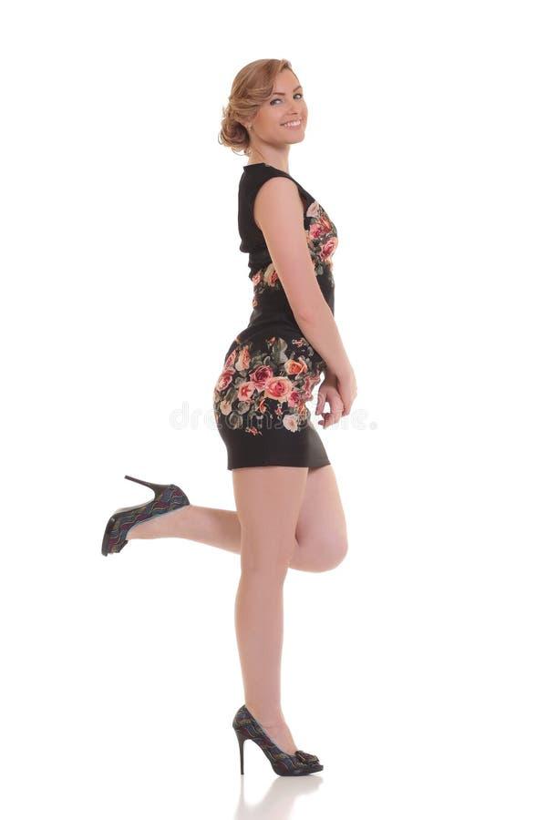 摆在白色背景的美丽的性感女孩 免版税库存图片