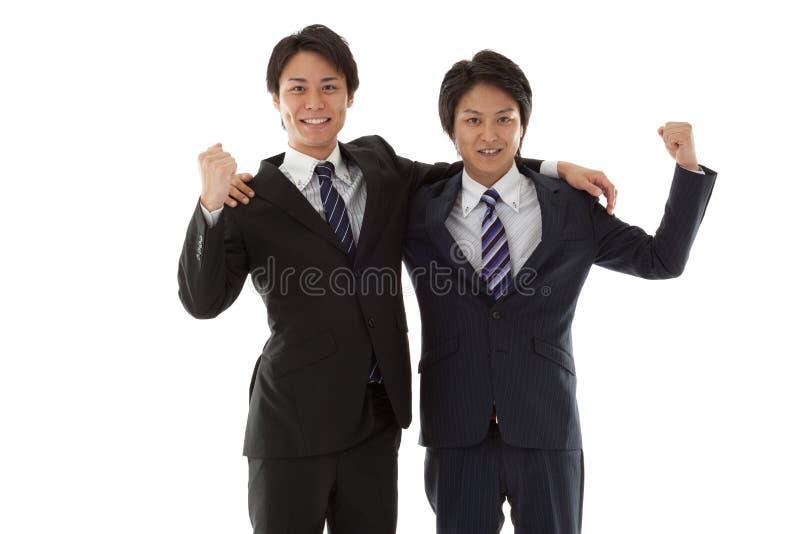 摆在胆量的二个新生意人 免版税库存图片