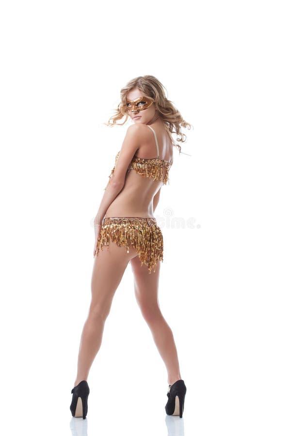 摆在色情服装的神奇亭亭玉立的妇女 库存照片