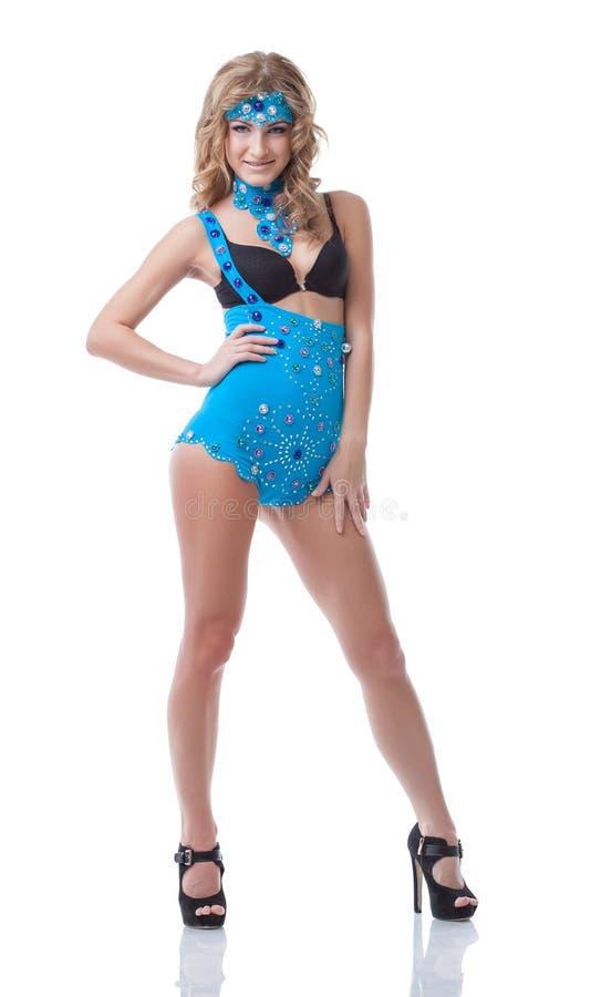 摆在蓝色色情服装的嬉戏的亭亭玉立的模型 库存图片
