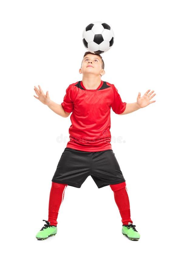 轻摇与球的小辈足球运动员 库存照片