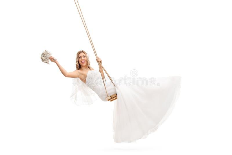 摇摆在木摇摆的新娘 库存图片