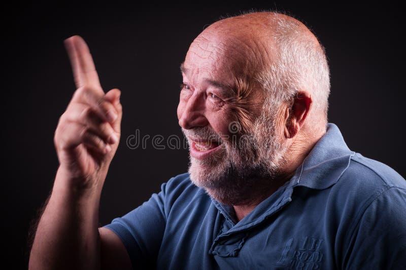 摇他的手的老人 库存图片