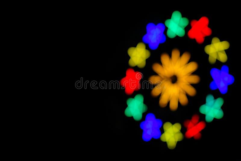 摘要五颜六色defocused在夜光节日 免版税库存图片
