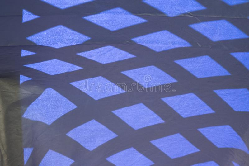 摘要渔在织品的蓝色畸变 免版税库存照片