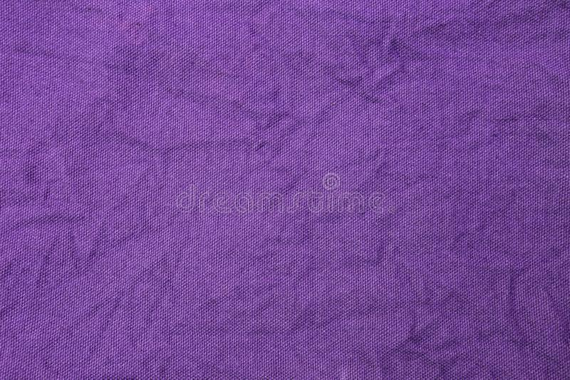 摘要蛾螺紫色织品纹理背景 免版税图库摄影