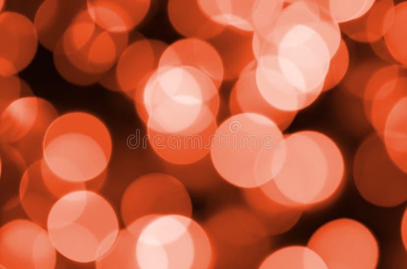 摘要被弄脏红色闪烁的亮光电灯泡光背景 圣诞节墙纸装饰概念迷离  免版税库存图片