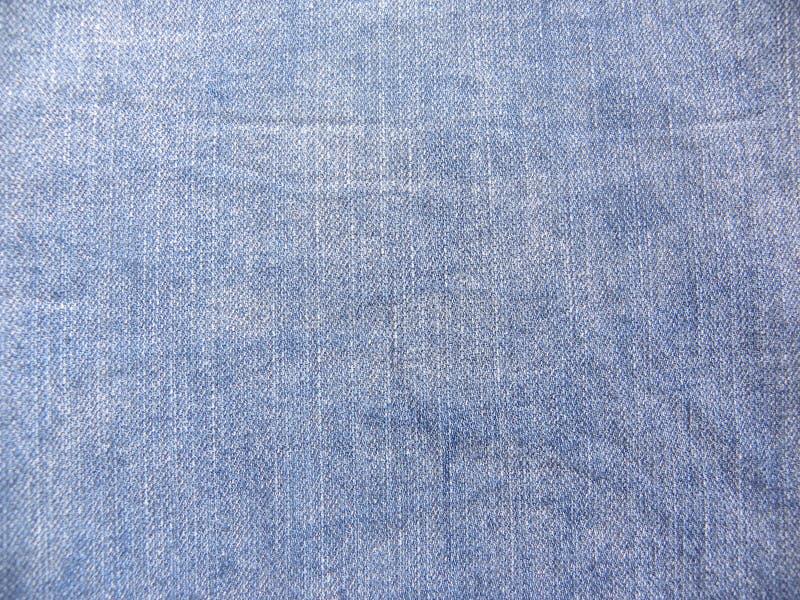 摘要退了色蓝色牛仔布牛仔裤纹理背景 免版税库存图片