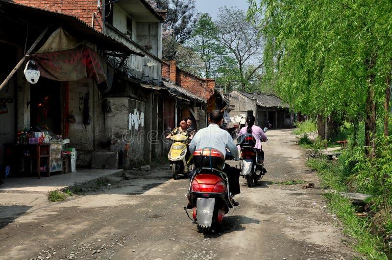 彭州,中国: 在老街道的摩托车 免版税库存图片