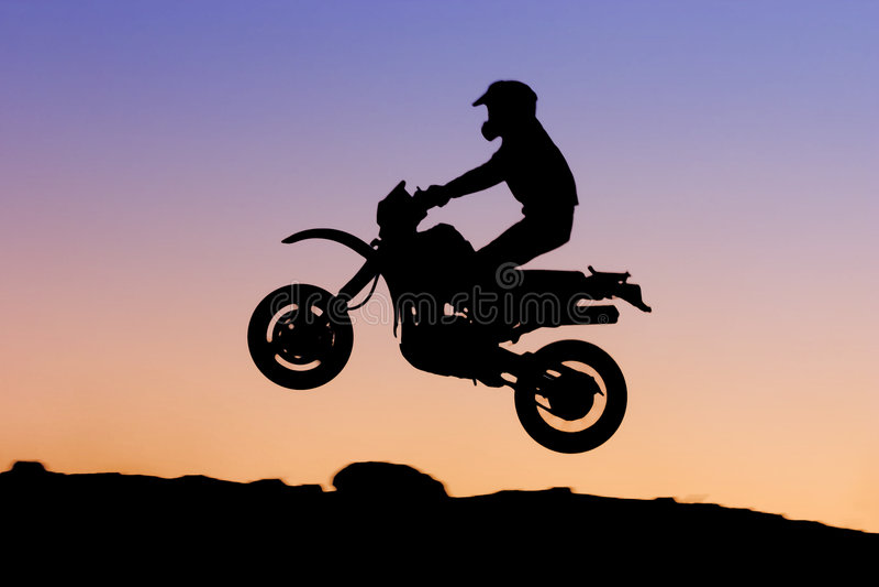 摩托车剪影 免版税图库摄影