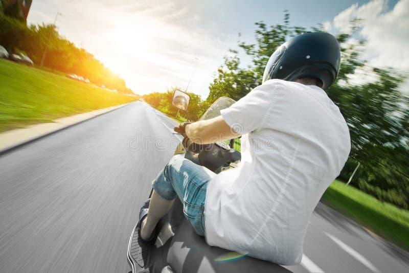 摩托车大路车手滑行车 免版税库存图片