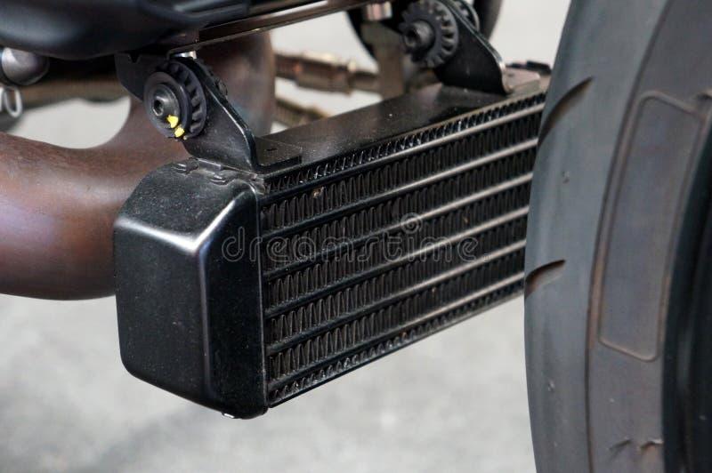 摩托车引擎的接近的油冷却器幅射器 免版税图库摄影