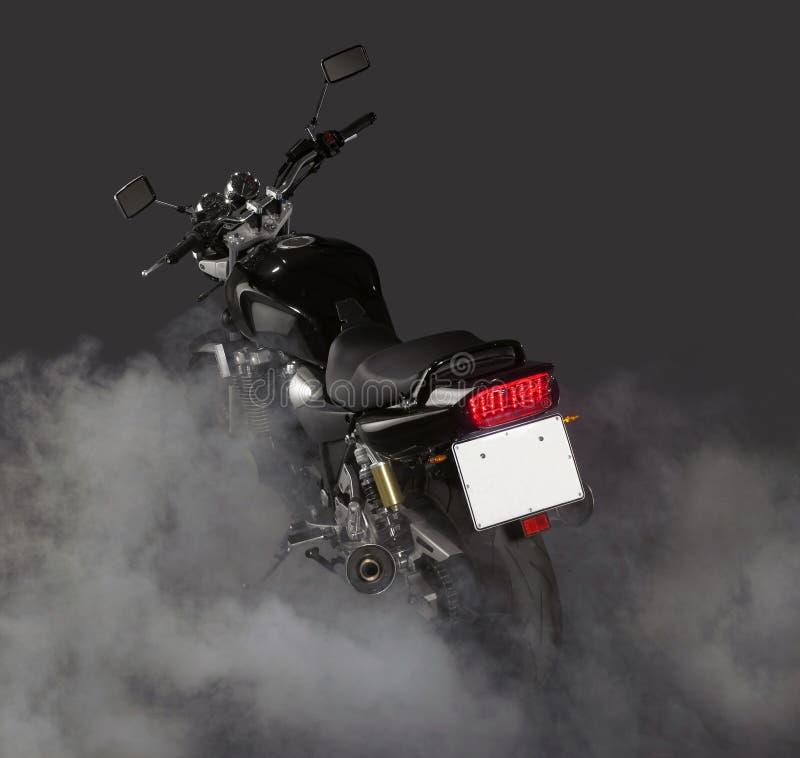 摩托车烧坏 免版税库存照片