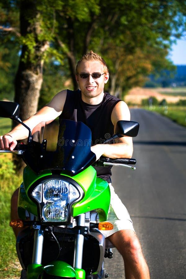 摩托车男孩 库存照片