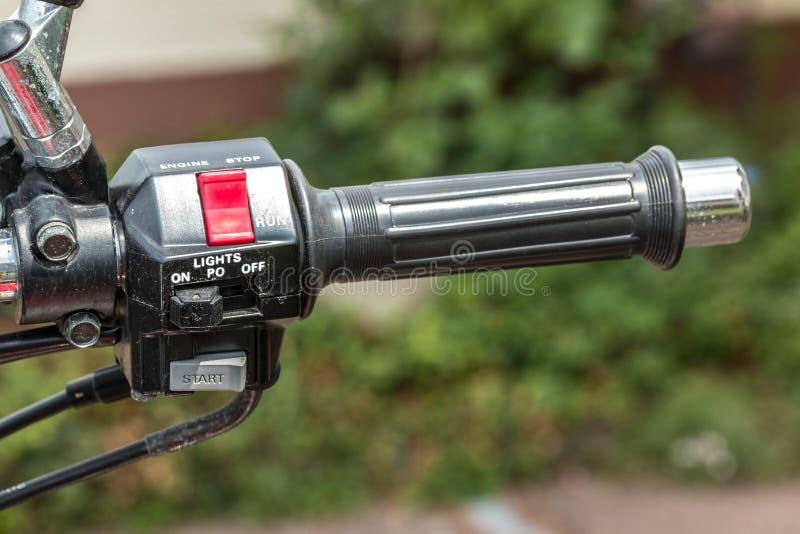 摩托车的加速器和光和垫铁 免版税库存图片