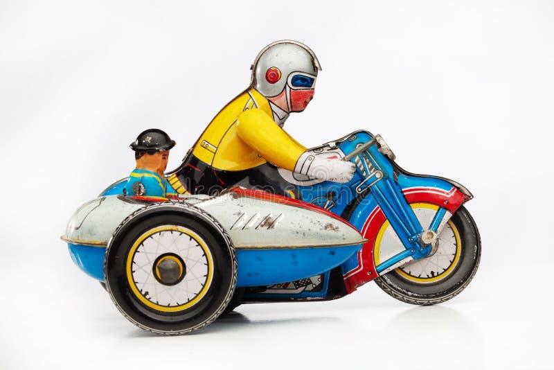 摩托车竟赛者罐子玩具 库存图片