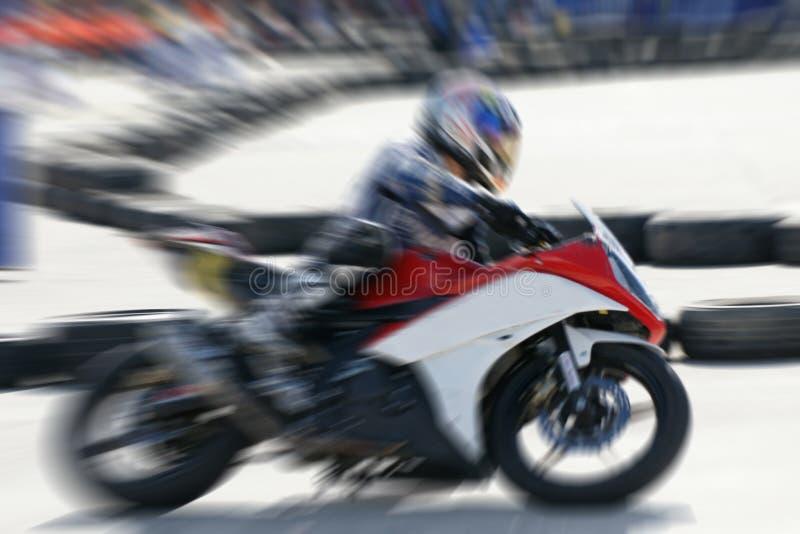 摩托车赛跑的高速运动 免版税库存照片