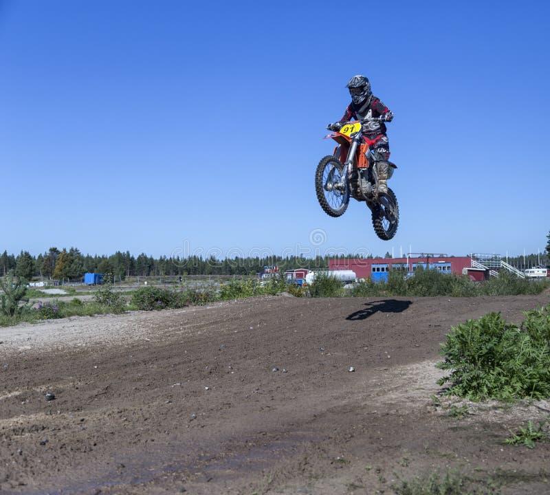 摩托车车手跳跃 库存图片