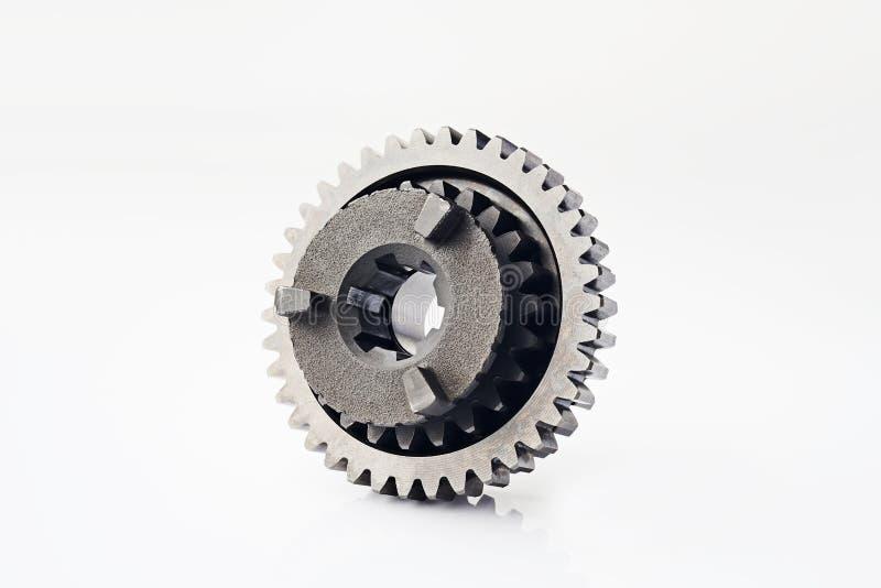摩托车零件 老金属链轮或鸟翼末端零件,摩托车齿轮传动齿轮减速比隔绝在白色背景 图库摄影