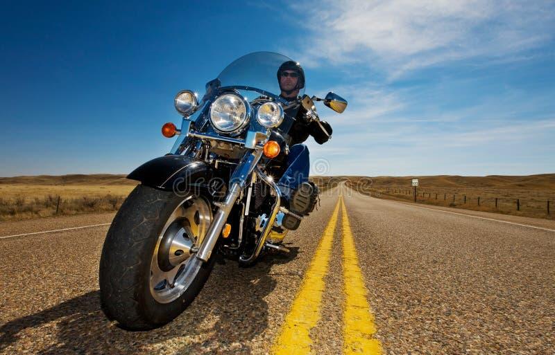 摩托车骑马 免版税库存照片