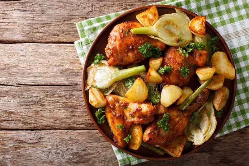 摩洛哥食物:鸡片断烘烤了用茴香和土豆 库存照片