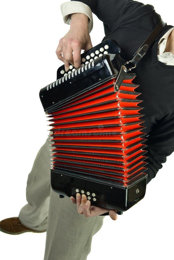 播放手风琴的年轻人 免版税库存照片
