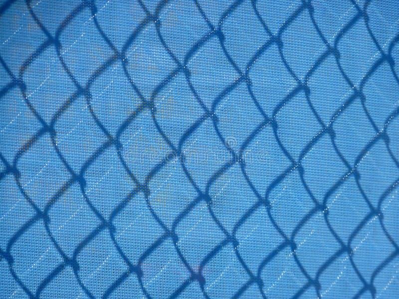 操刀与阴影的蓝色滤网 免版税图库摄影
