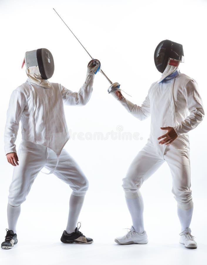 操刀运动员或球员被隔绝在白色背景 免版税图库摄影
