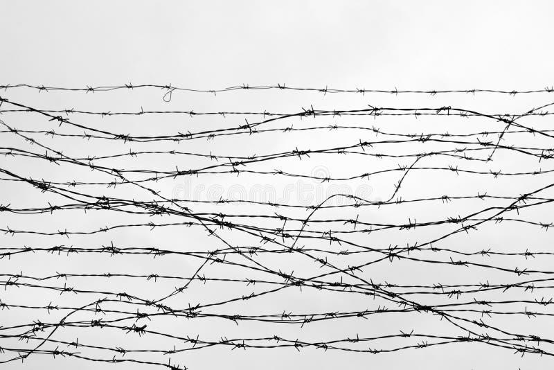 操刀 有刺的范围电汇 让 监狱 刺 封锁 一个囚犯 浩劫集中营 囚犯 压抑backgr 图库摄影