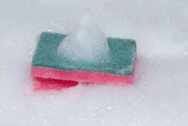 擦洗用的厚垫或去壳机有泡沫的 库存照片