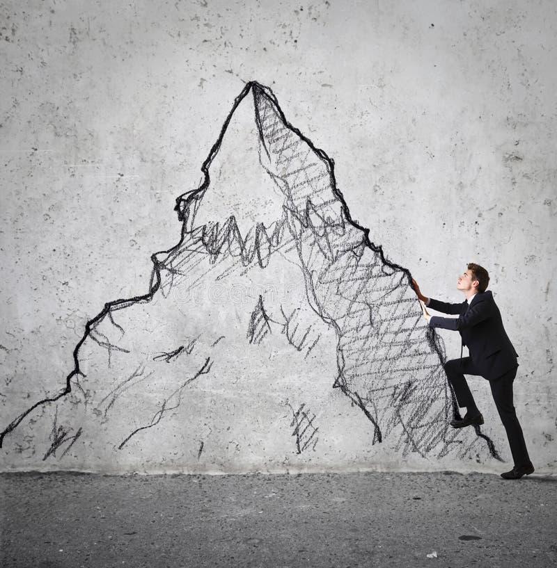 攀登山的商人 图库摄影