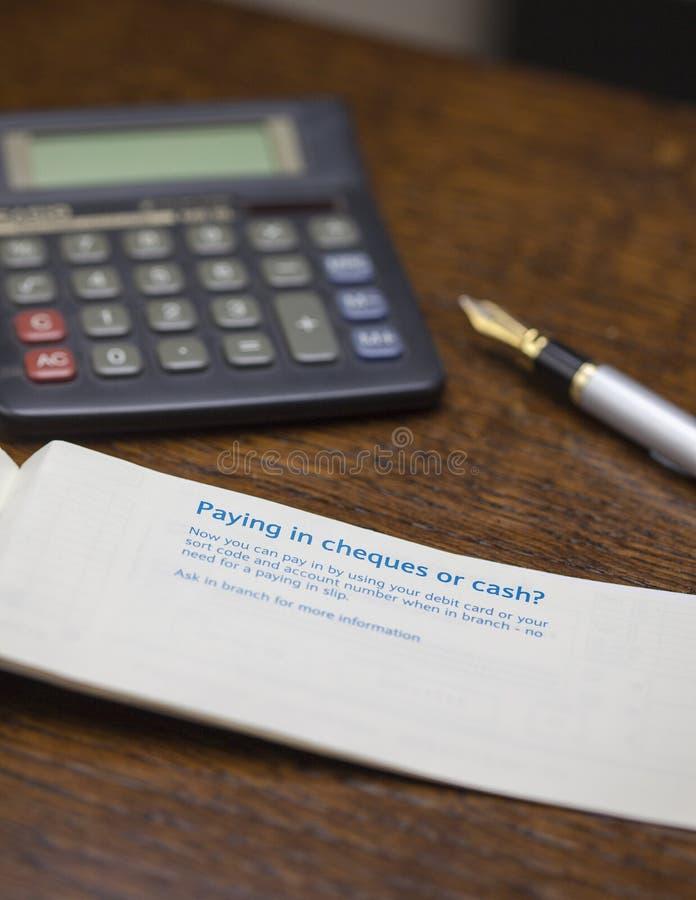 支付在书的银行 库存照片