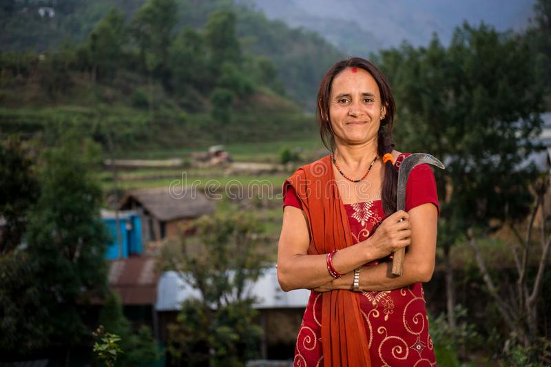 收获尼泊尔的妇女,Doru,Huwas谷,尼泊尔 免版税库存照片
